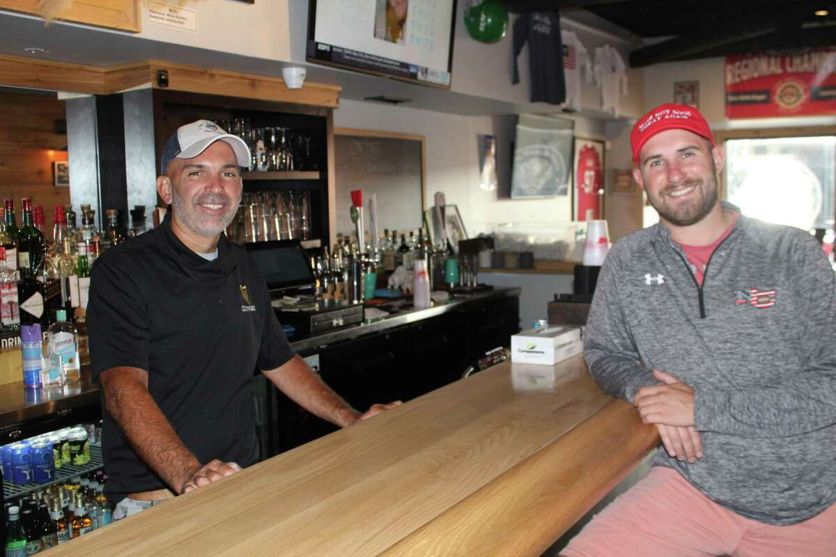 Rich Hewitt, managing partner of the White Buffalo in New Canaan, and Frank Granito, organizer of the Hot Dog Challenge, prepare for this year's hot dog eating contest, to be held in the Buffalo's courtyard on Saturday, Sept. 19. It was postponed from Aug. 29.