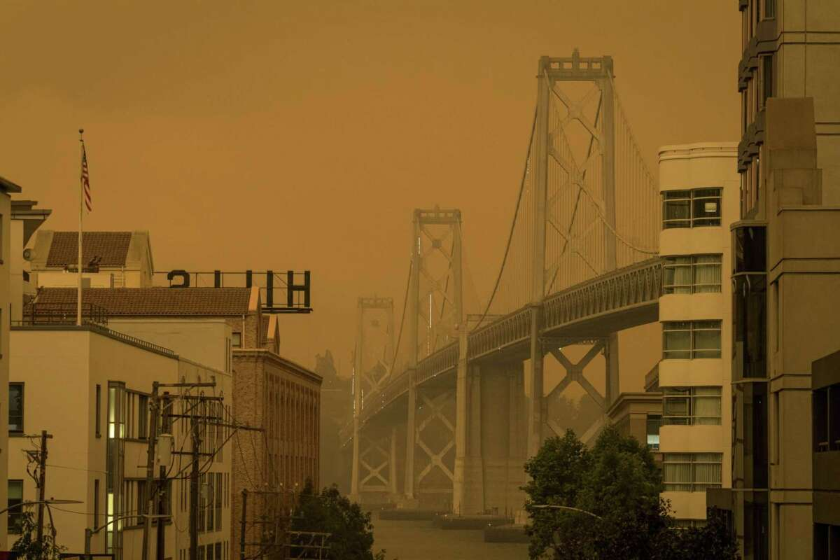 Smoke hangs over the Oakland-San Francisco Bay Bridge in San Francisco on Sept. 9, 2020.