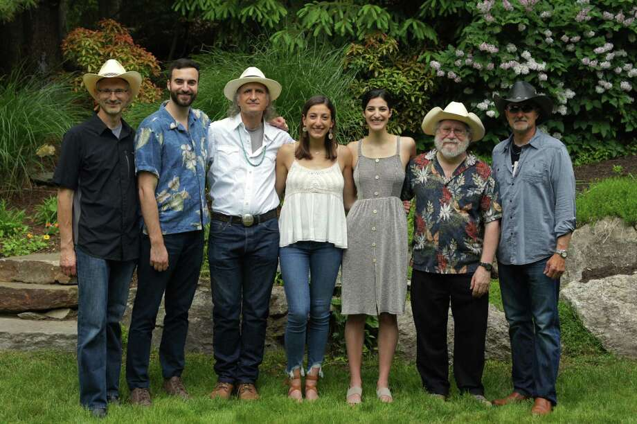 """Award-winning Nashville recording artists and local country western band, Gunsmoke is performing an outdoor Music for Hope concert, Country Rock and Blues at the Piedmont Club in Darien on Saturday, Sept. 26. Gunsmoke band members Jeff DeMaio, Nick DeMaio Jr., Van Manakas, Rebecca DeMaio, Christina Mae, Guy """"Fooch"""" Fischetti and Nick DeMaio III. Photo: Contributed /"""