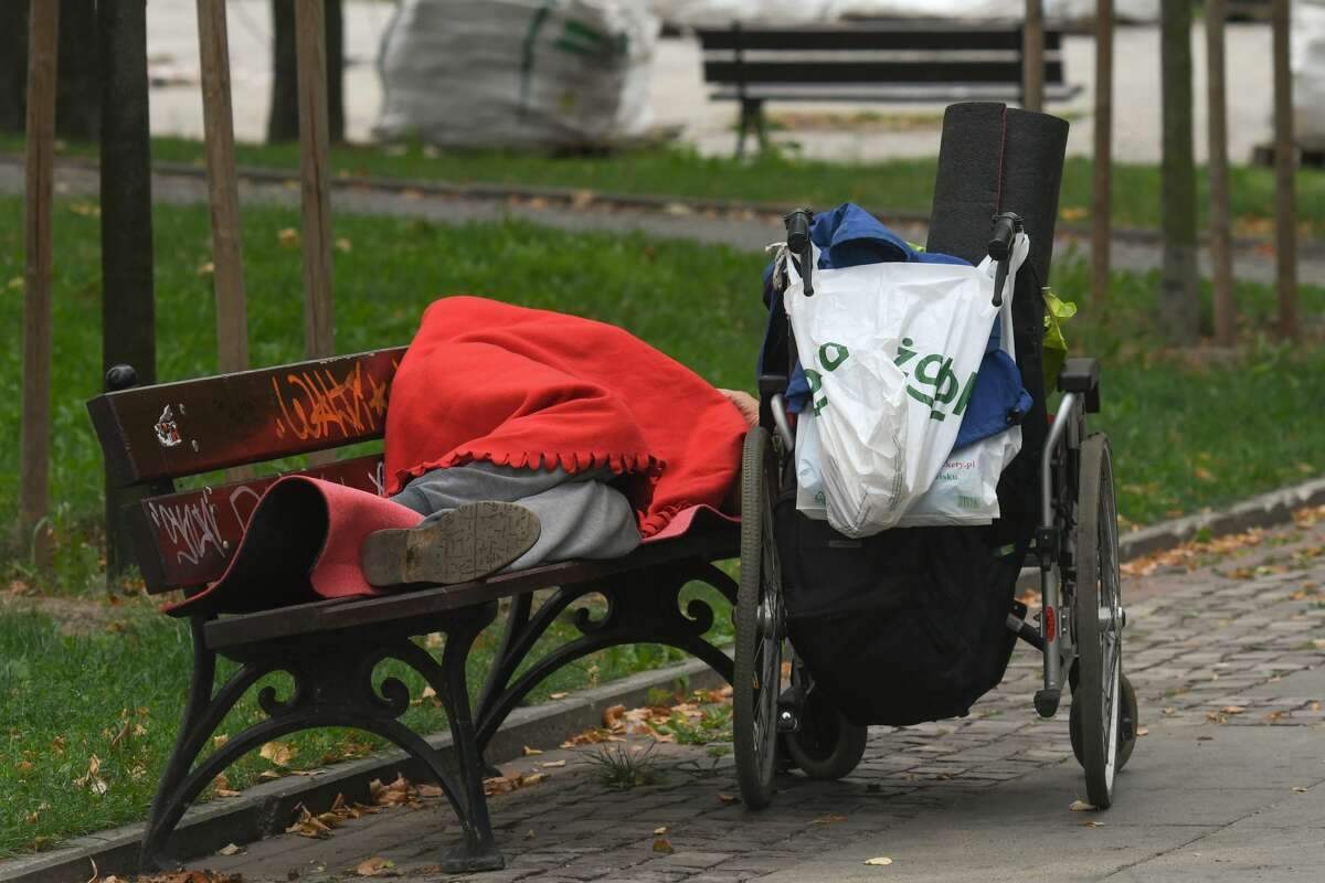 An homeless person sleep on a bench near the Palace of Culture and Science in Warsaw. On Sunday, September 1, 2019, in Warsaw, Poland. (Photo by Artur Widak/NurPhoto via Getty Images)