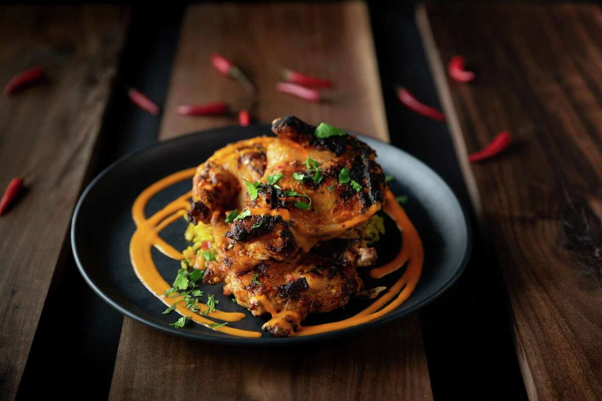 At Peli Peli Kitchen, the signature Peli Peli chicken is marinated in peri peri (birds eye chile) and grilled over a wood fire.