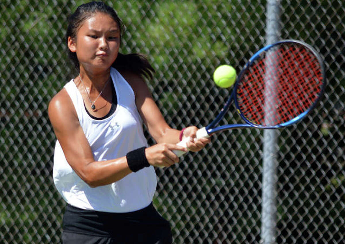 Edwardsville's Chloe Koons hits a two-handed backhand on Sept. 5 during her No. 1 singles match against Belleville East in the Champions flight of the Heather Bradshaw Memorial Invitational.