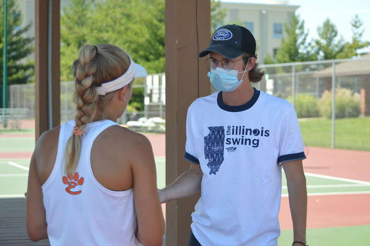 Edwardsville assistant coach Jonathan Koons, right, talks to senior Grace Hackett on Sept. 5 during the Champions flight finals against Belleville East in the Heather Bradshaw Memorial Invitational. Koons' sister, sophomore Chloe Koons, is the No. 1 singles player for the Tigers.