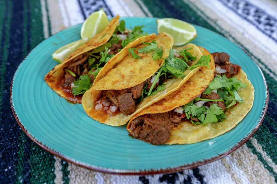 Birria tacos, a hot San Antonio dishes right now, are seen Thursday, Aug. 27, 2020, at Chuck's Food Shack. Birria is a meaty blend of meaty, soupy stew that's also used as a dipping sauce for tacos. The slow roasted meat is fork tender. Photo: William Luther, Staff / Staff / ©2020 San Antonio Express-News