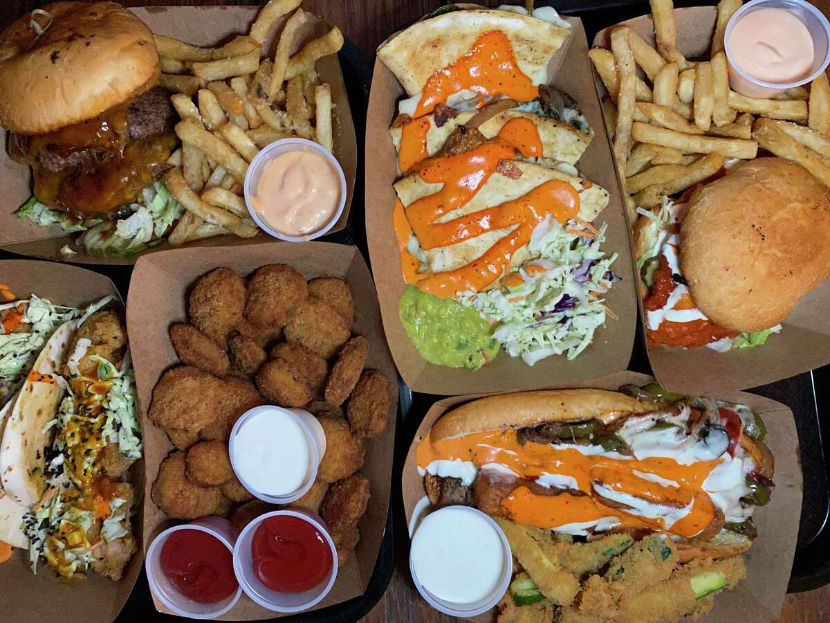 Elsewhere Garden Bar & Kitchen specializes in bar-style food including, clockwise from top left, a Double BBQ Burger, spinach-artichoke quesadillas, a Buffalo chicken sandwich, a Philly cheesesteak, fried pickles and Baja shrimp tacos.