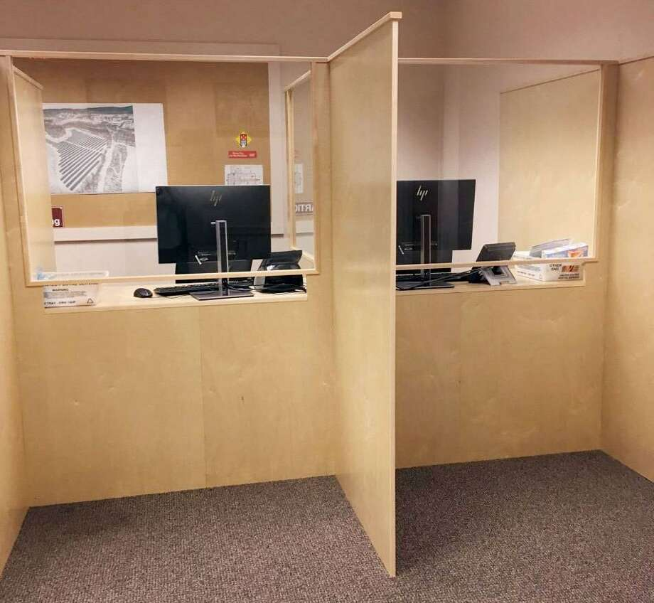 Two (of four) new work stations created in the conference room at Wilton Town Hall for workers in the Town Clerk's office to process absentee ballots for the upcoming November election. Photo: Town Of Wilton Photo