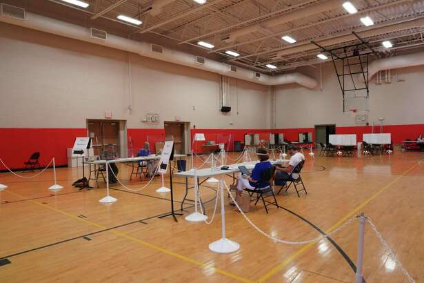 The New Canaan High School gymnasium is shown on Primary Day for voters in Connecticut, Tuesday, Aug. 11. New Canaan Town Clerk Claudia Weber provides this information about going to exercise the right to vote by absentee ballot, or at the three polling places in the town this Tuesday, Nov. 3.