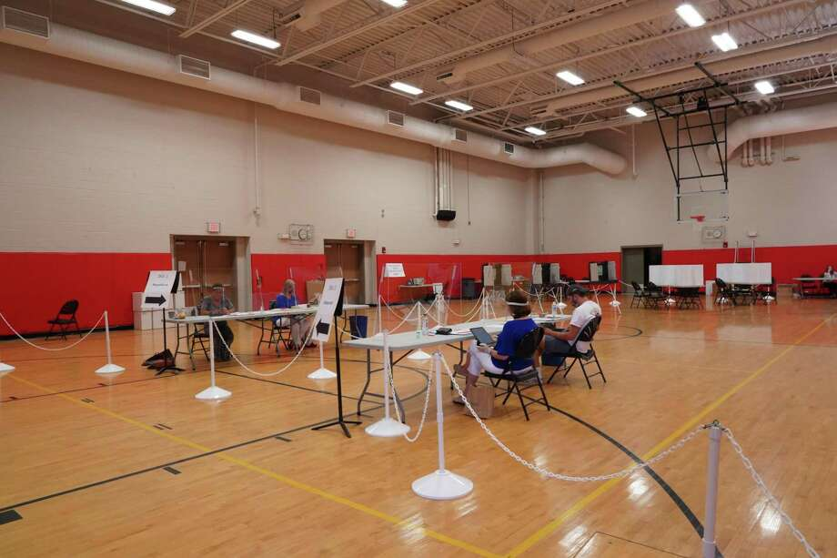 The New Canaan High School gymnasium is shown on Primary Day for voters in Connecticut, Tuesday, Aug. 11. New Canaan Town Clerk Claudia Weber provides this information about going to exercise the right to vote by absentee ballot, or at the three polling places in the town this Tuesday, Nov. 3. Photo: Grace Duffield / Hearst Connecticut Media