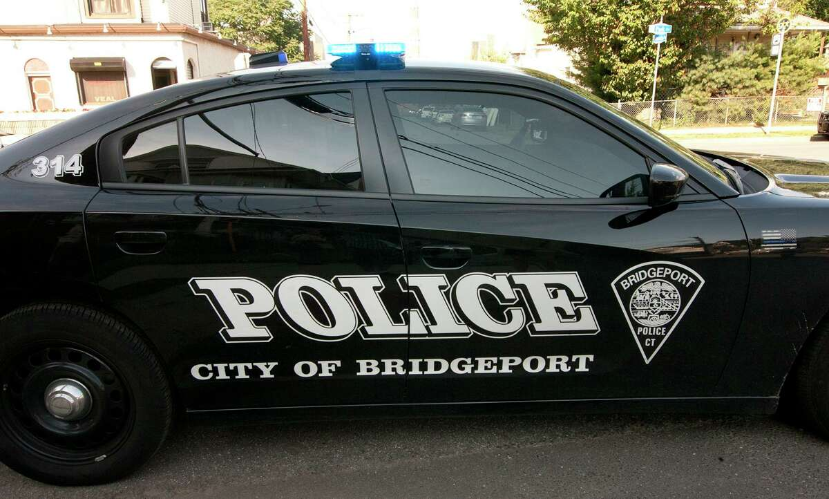 File photo of a Bridgeport, Conn., police cruiser at a crime scene on Friday, June 29, 2018.