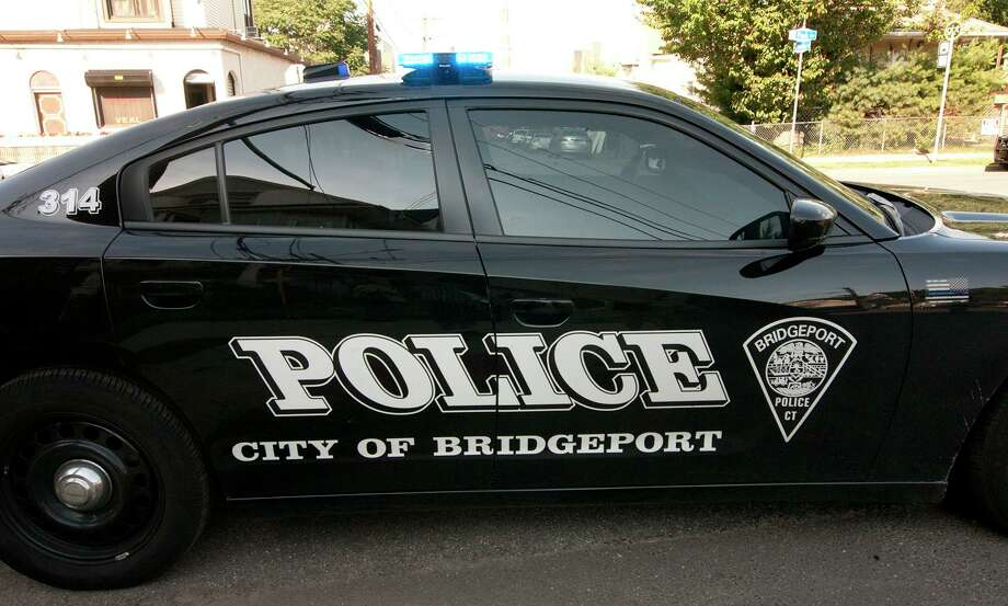 File photo of a Bridgeport, Conn., police cruiser at a crime scene on Friday, June 29, 2018. Photo: Christian Abraham / Hearst Connecticut Media / Connecticut Post