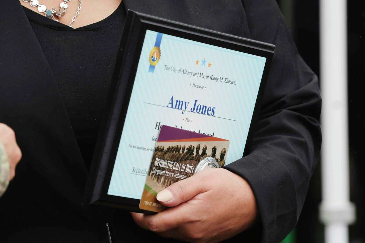 Amy Jones, the recipient of the 2020 Henry Johnson Award for Distinguished Community Service, holds the plaque she received during an event at Henry Johnson Park to mark the 4th Annual Henry Johnson Day on Thursday, Sept. 10, 2020, in Albany, N.Y. (Paul Buckowski/Times Union)