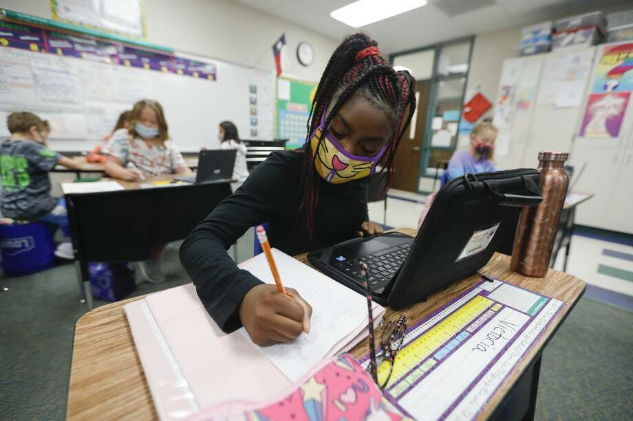Fifth grader Victoria Thomas uses her laptop to work on math at William Loyd Meador Elementary School, Thursday, Sept. 10, 2020, in Willis. Students at Willis ISD returned to in-person school on Tuesday, Sept. 8. Photo: Jason Fochtman/Staff Photographer / 2020 ? Houston Chronicle
