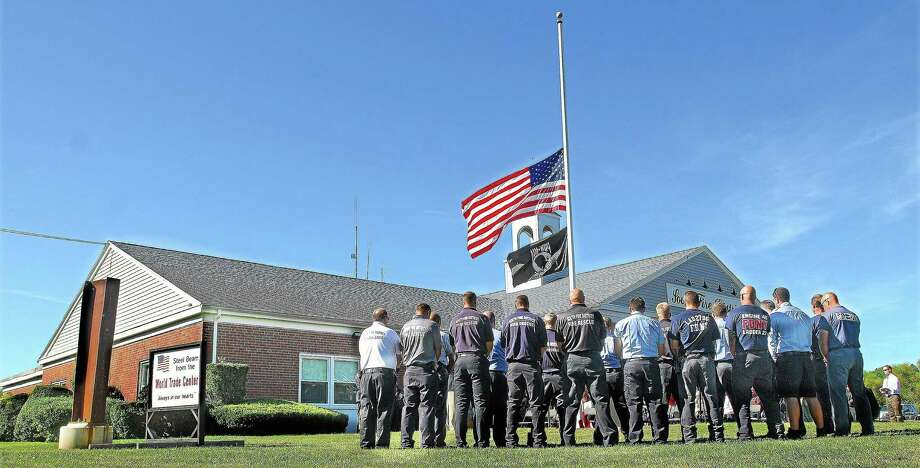 File photo of firefighters of South District Fire in Middletown, Conn., during a ceremony held remembering the victims of the September 11, 2001, terror attacks. Photo: Contributed Photo