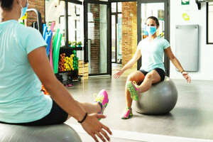 This photo from OSF HealthCare shows an effective way to wear a mask while working out in a low-intensity exercise. OSF respiratory therapist Johnna Steller suggested beginning at a lower level of exercise intensity than what you're used to and then increase exertion, always being aware of heart rate, while exercising wearing a mask. (Submitted by OSF HealthCare|For Health Watch)