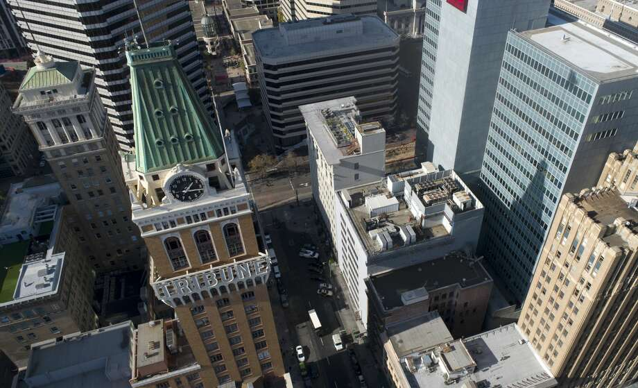 FILE-- The Tribune Tower is seen from this drone view in downtown Oakland on Thursday, Nov. 21, 2019. Tribune Tavern inside Oakland's Tribune Tower is expected to close. Photo: MediaNews Group/The Mercury News/MediaNews Group Via Getty Images / Bay Area News Group