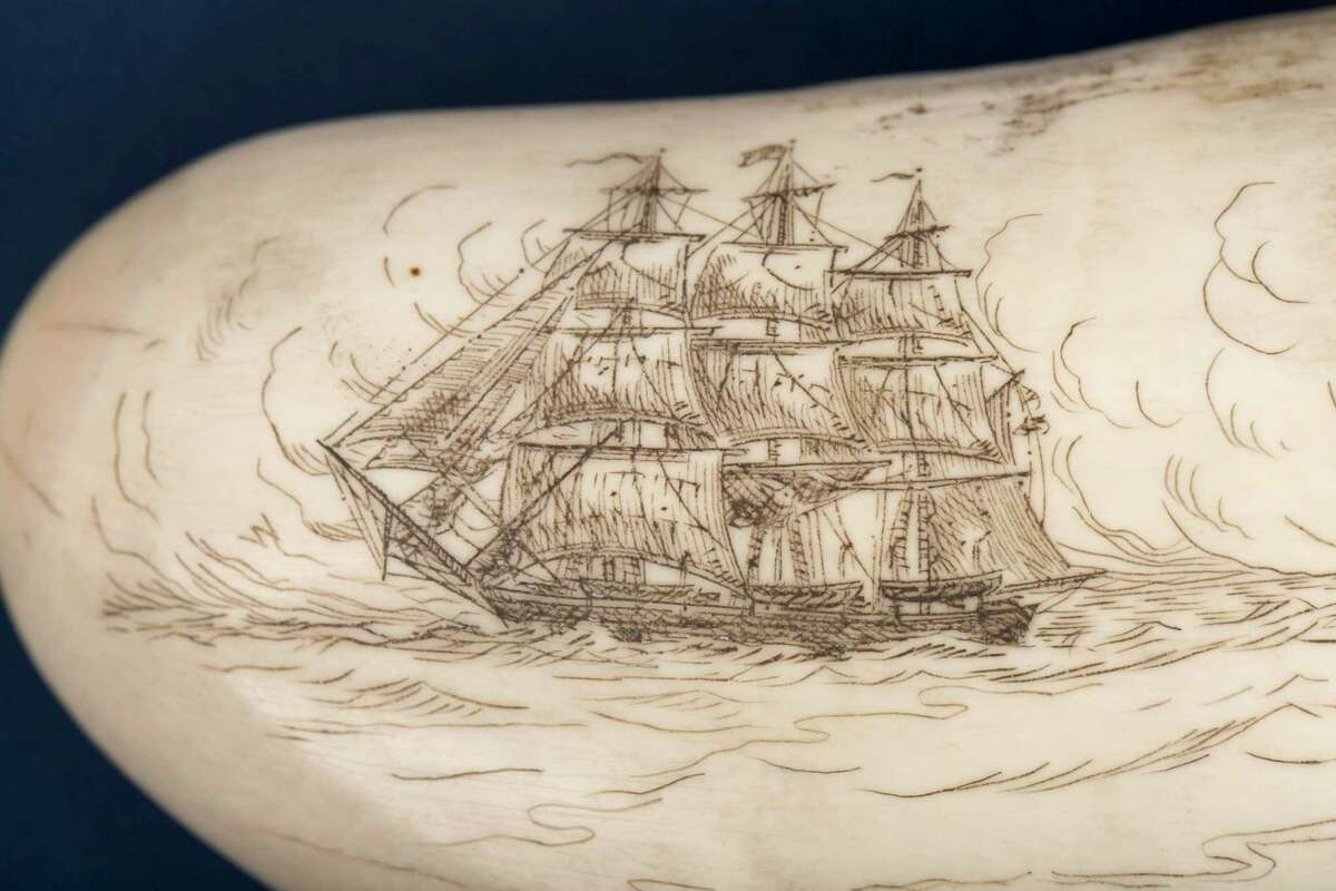 Detail of scrimshaw depicting a whaleship by William Perry. Perry was son of New Bedford-born whaleman Frank Antone Perry and an Azorian-born woman named Emily.In addition to working as a commercial scrimshander, Perry also worked as a tattoo artist.