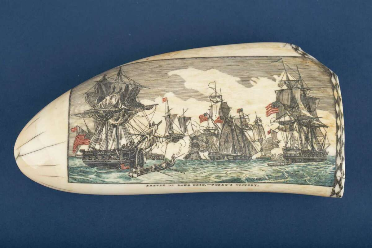 Scrimshaw depicts the Battle of Lake Erie by N.S. Finney. Brought home by Captain Butts aboard bark Bramin, circa 1848. Finney is recognized as one of the finest scrimshaw artists of all time. He spent 27 years at sea, 1830-1857, as a whaler.
