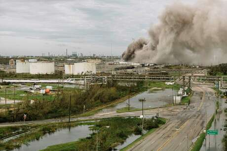 A fire burns at a BioLab industrial site in Westlake, La., near Lake Charles, on Thursday, Aug. 27, 2020, after Hurricane Laura passed through the region. The hurricane struck a coast studded with oil, gas and chemical plants. Previous storms have released a toxic mix of pollution, often affecting minority communities. (William Widmer/The New York Times)