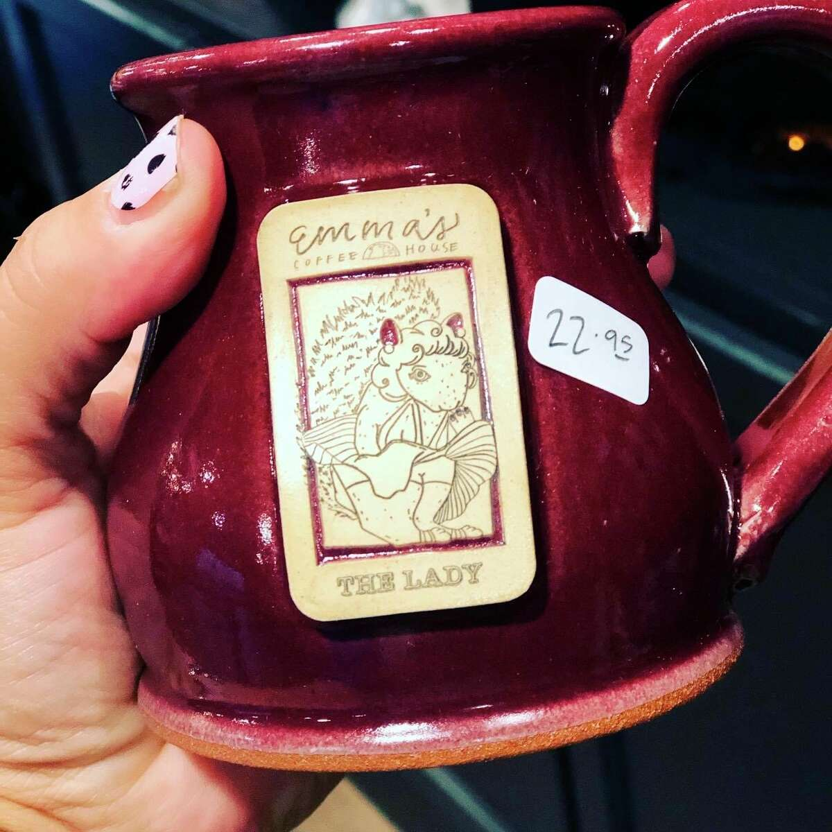 Artist and co-owner of Emma's Coffee House, Jessi Severance, has released a new series of mugs depicting a humorous line of