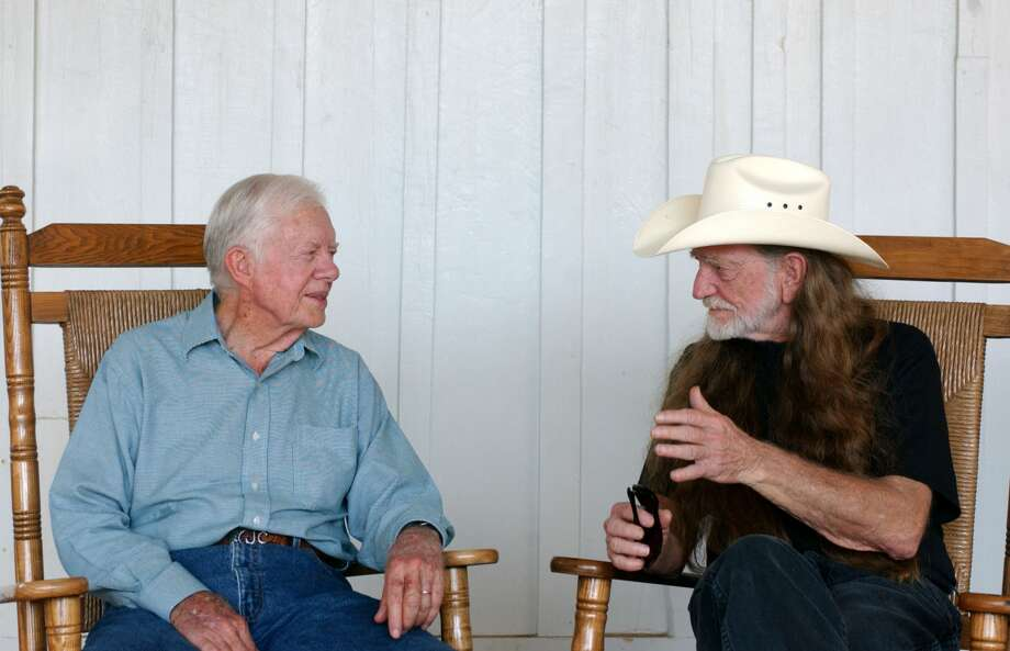 "Former President Jimmy Carter and musician Willie Nelson at the taping of ""CMT Homecoming: Jimmy Carter in Plains,"" which premiered on CMT in December 2004. (Photo by R. Diamond/WireImage) Photo: R. Diamond/WireImage"