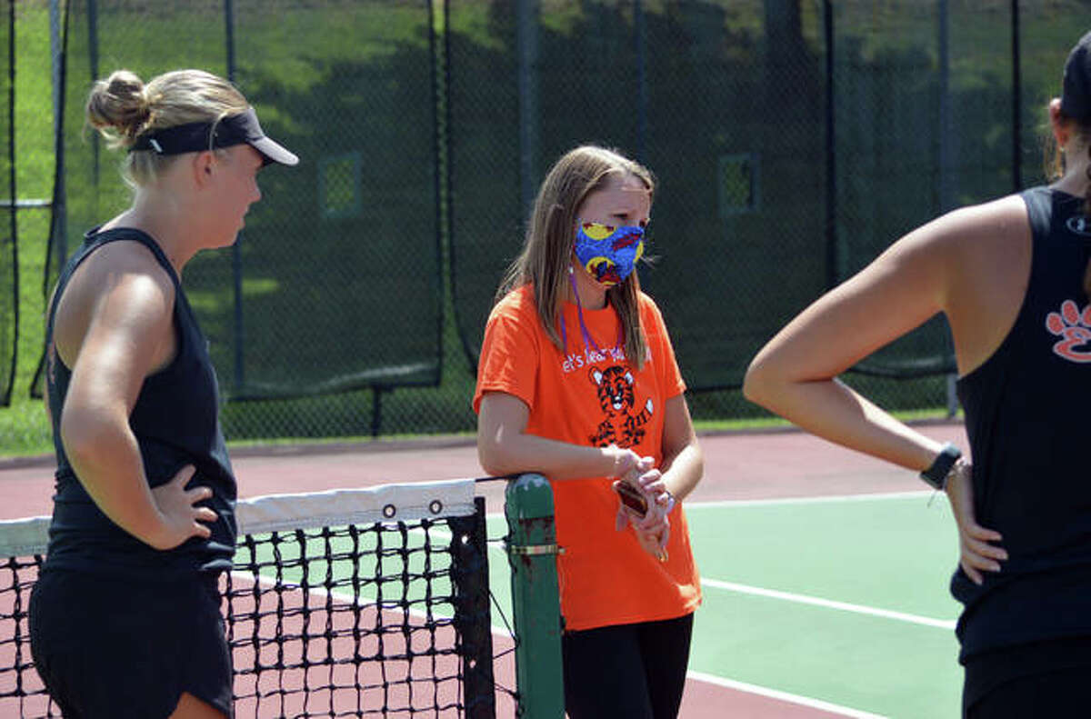 Edwardsville assistant coach Emily Cimarolli talks to her players on Sept. 4 before a dual match at Althoff in the opening round of the Heather Bradshaw Memorial Invitational.