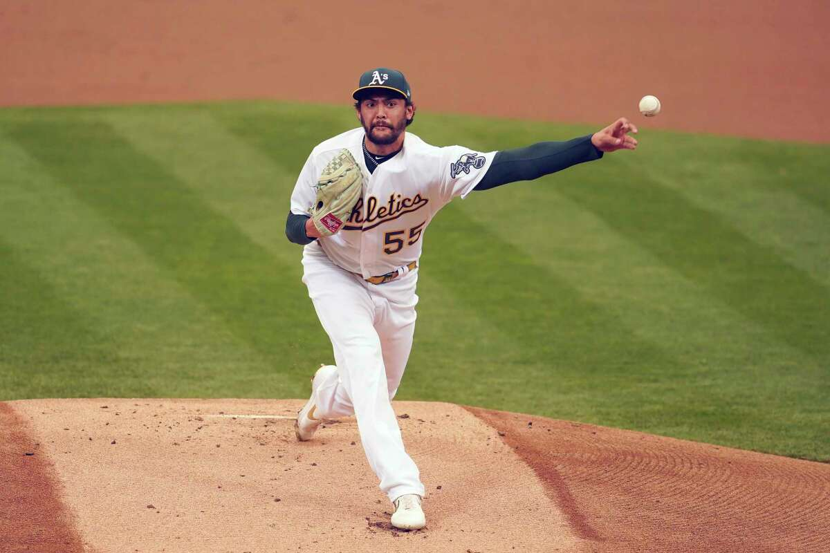 Oakland Athletics' Sean Manaea pitches against the Houston Astros during the first inning of a baseball game in Oakland, Calif., Thursday, Sept. 10, 2020. (AP Photo/Jeff Chiu)