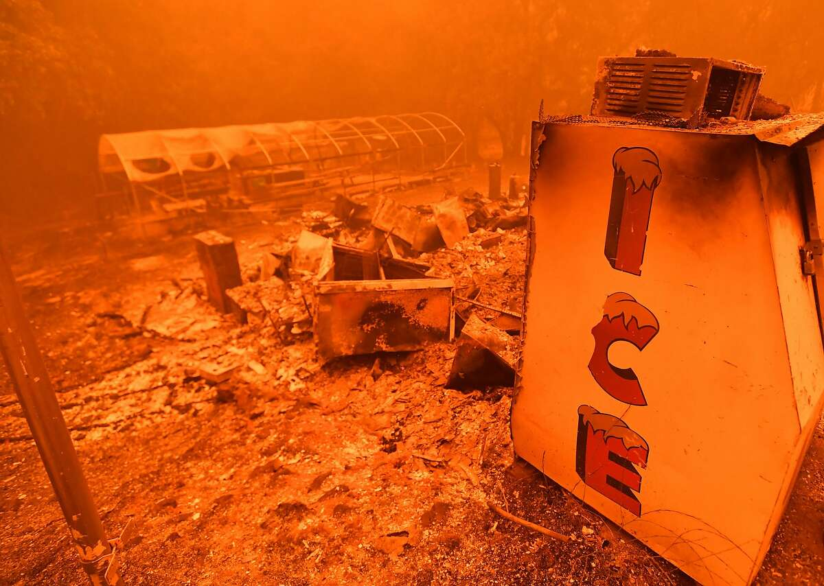 A singed ice machine sits over a burned store during the Bear fire, part of the North Lightning Complex fires, in unincorporated Butte County, California on September 09, 2020. - Dangerous dry winds whipped up California's record-breaking wildfires and ignited new blazes Tuesday, as hundreds were evacuated by helicopter and tens of thousands were plunged into darkness by power outages across the western United States. (Photo by JOSH EDELSON / AFP) (Photo by JOSH EDELSON/AFP via Getty Images)