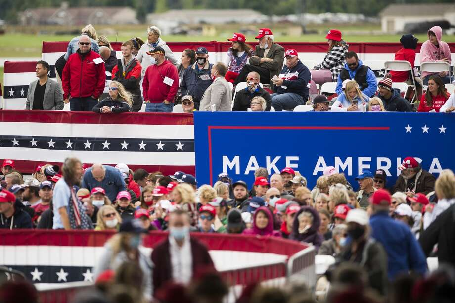 Supporters of President Donald Trump enter a hangar at MBS International Airport as they away the President's arrival Thursday, Sept. 10, 2020 in Freeland. (Katy Kildee/kkildee@mdn.net) Photo: (Katy Kildee/kkildee@mdn.net)