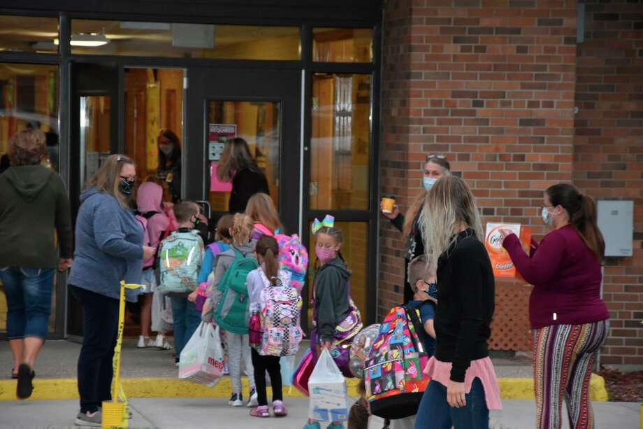 Students at Jefferson Elementary return for the first day of school on Sept. 8. During a Manistee Area Public Schools Board of Education meeting on Wednesday, Jefferson principal Julia Raddatz said parents were patient and understanding regarding the new safety protocols and procedures. (Erin Glynn/News Advocate)