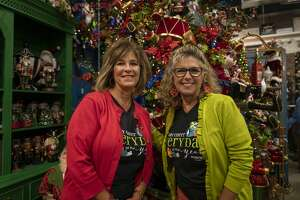 Miss CayceÕs Wonderland co-owners Becky McCraney, left, and Kathy Harrison, right, pose in front of the Nutcracker tree Thursday, Sept. 10, 2020 for the holiday season at 1012 Andrews Hwy. Jacy Lewis/Reporter-Telegram