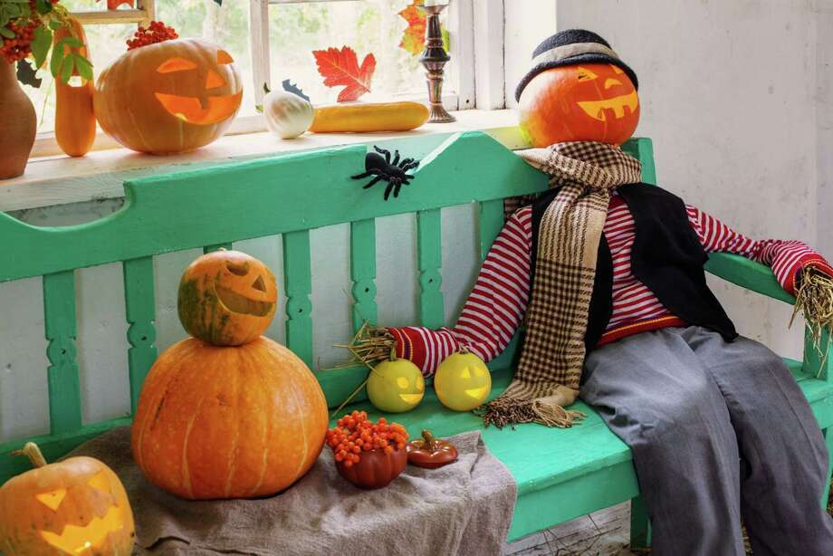 Jack-o'-Lantern Scarecrow: Gather the family and create a scarecrow to sit on your front porch. You can make the face using a jack-o'-lantern, and get creative building the rest. If you don't have hay to fill your scarecrow, use crumpled newspaper instead. Photo: Maya23K - Getty Images