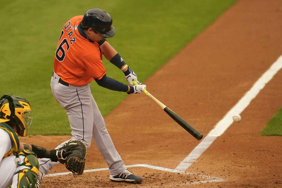 Houston Astros' Aledmys Diaz hits a single against the Oakland Athletics during the sixth inning of a baseball game in Oakland, Calif., Thursday, Sept. 10, 2020. (AP Photo/Jeff Chiu)