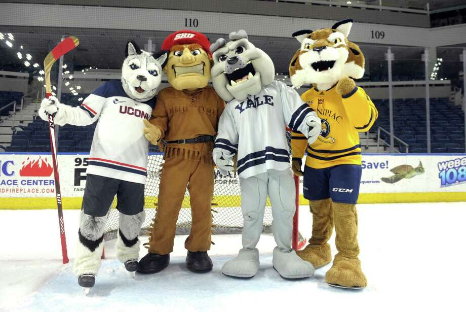 UConn's Johnathan the Husky, Sacred Heart's Big Red the Pioneer, Yale's Boola the Bulldog and Quinnipiac's Boomer the Bobcat, the four mascots from Connecticut universities participating in the Connecticut Ice gather at Bridgeport's Webster Bank Arena in December. It was announced on Thursday that the start of the college hockey season will be delayed due to COVID-19. Photo: Ned Gerard / Hearst Connecticut Media / Connecticut Post