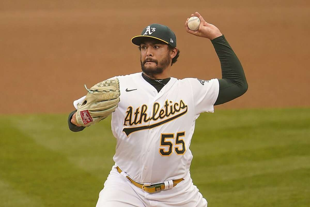 Oakland Athletics' Sean Manaea (55) pitches against the Houston Astros during the fourth inning of a baseball game in Oakland, Calif., Thursday, Sept. 10, 2020. (AP Photo/Jeff Chiu)