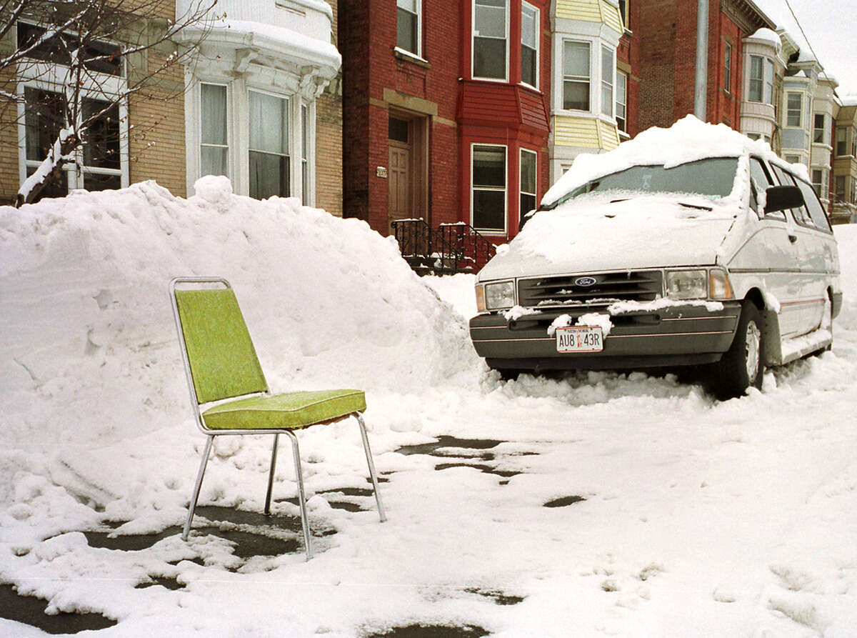 If you spot a folding chair seemingly abandoned in a parking spot in Troy after a nasty winter storm, you had better move along. That spot is taken.