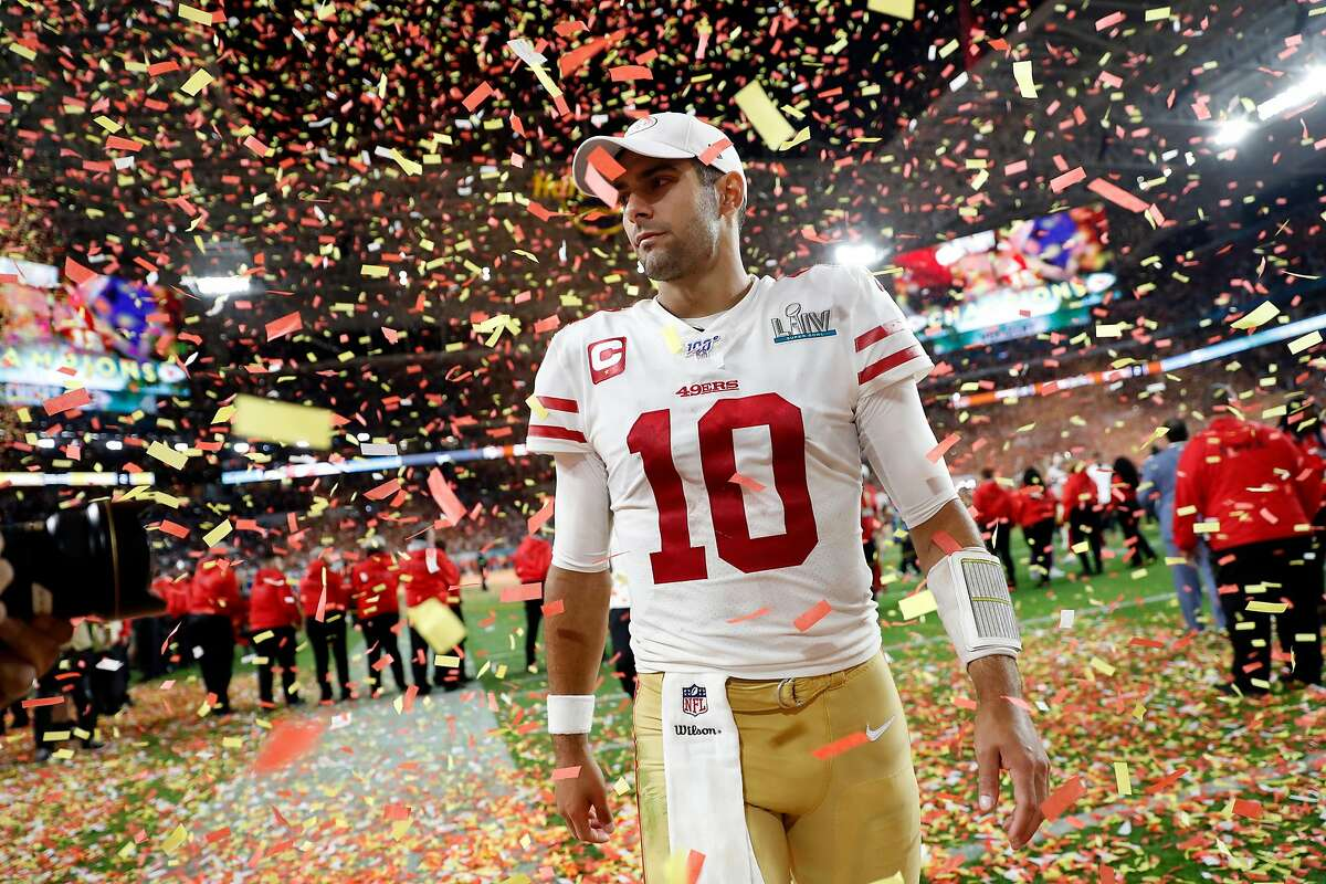San Francisco 49ers' Jimmy Garoppolo walks off the field after 31-20 loss to Kansas City Chiefs during Super Bowl LIV at Hard Rock Stadium in Miami Gardens, Florida, on Sunday, February 2, 2020.