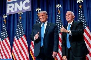 Mike Pence, right, sold out when he allied himself with the immigration policies of Donald Trump in order to become vice president.