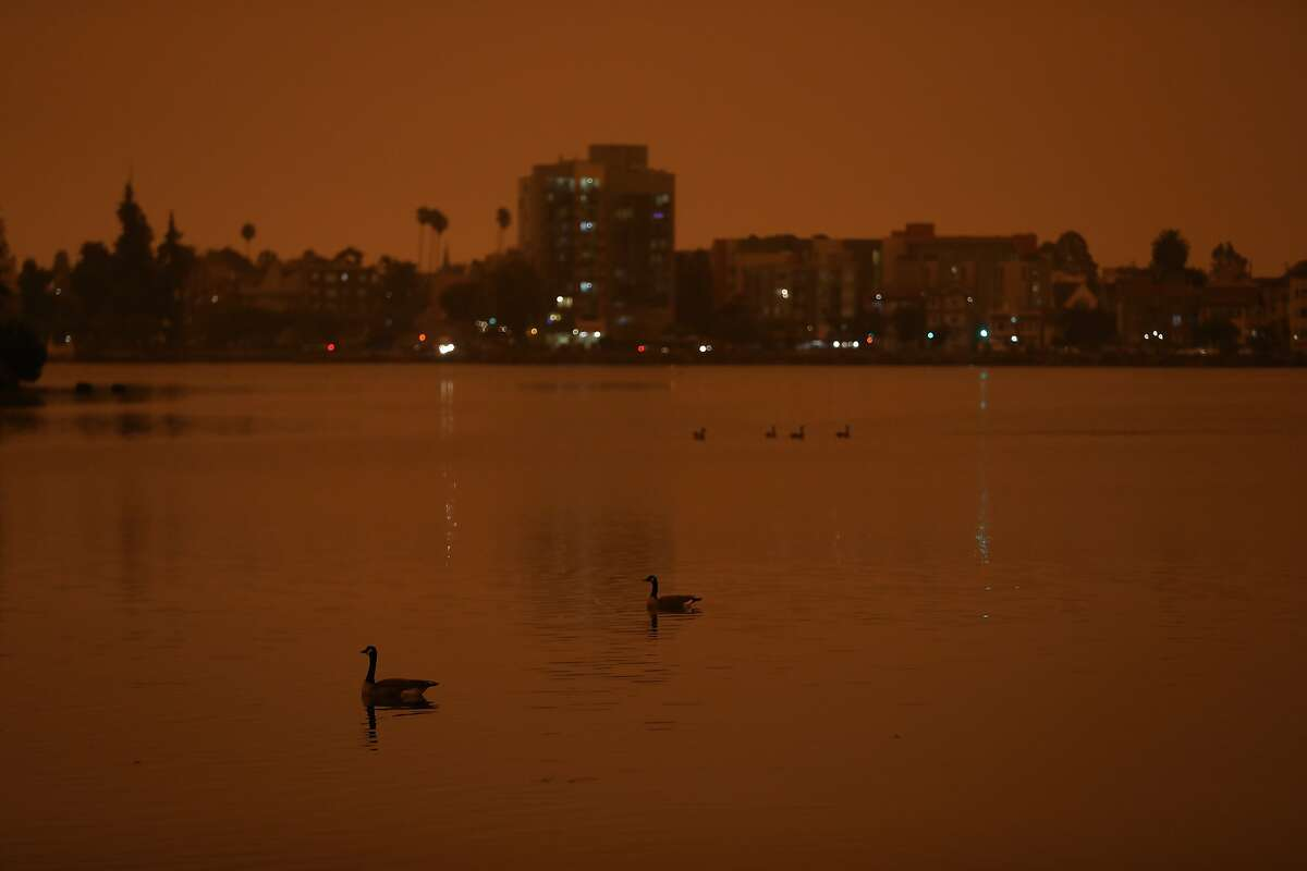 A dark and blood orange sky, seen from Lake Merritt, covered Oakland this morning due to wildfires on Wednesday, September 9, 2020, in Oakland, Calif.