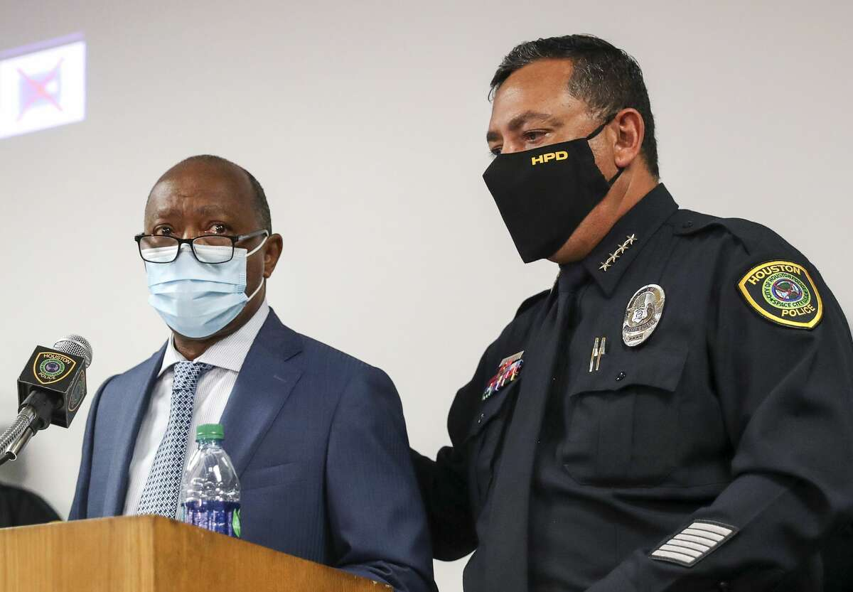Houston Police Chief Art Acevedo, right, comforts Houston Mayor Sylvester Turner as he becomes emotional during a press conference while talking about the shooting death of Nicolas Chavez, Thursday, Sept. 10 2020, at HPD headquarters in Houston. Chavez was shot and killed April 21 by several police officers during a confrontation in Denver Harbor.