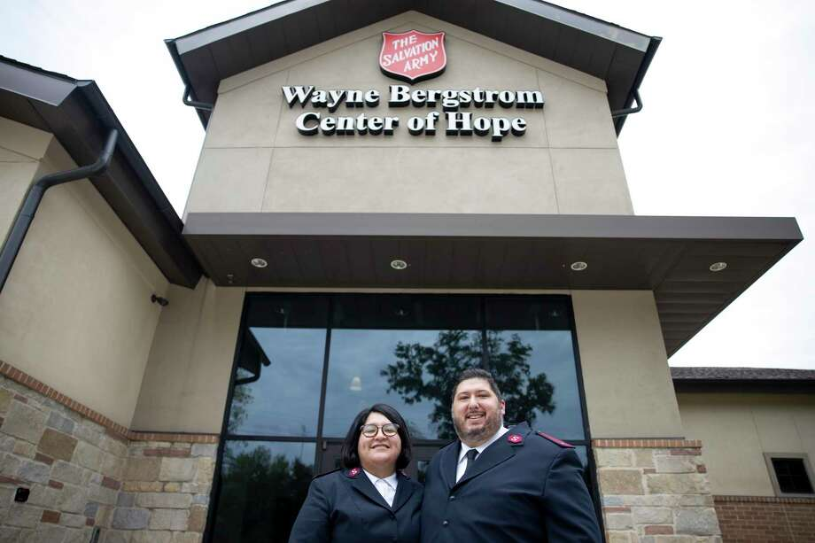 Claudia and James Guzman pose for a portrait in front of the Salvation Army emergency shelter in Conroe, Tuesday, Sept. 8, 2020. They moved to Conroe in June after James accepted the position of Commanding Officer. Photo: Gustavo Huerta, Houston Chronicle / Staff Photographer / 2020 © Houston Chronicle