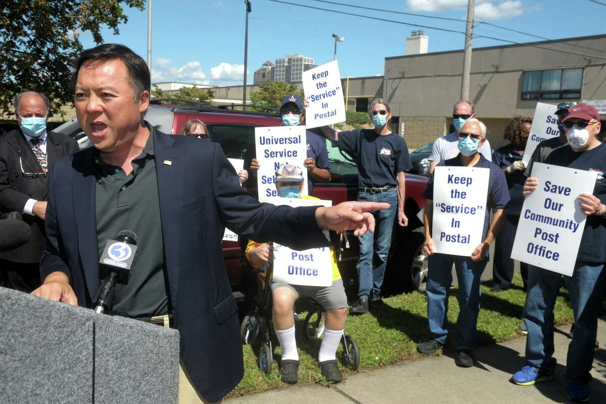 Connecticut Attorney General William Tong speaks during a news conference with postal workers across the street from the General Post Office in New Haven, Conn. Aug. 20, 2020.