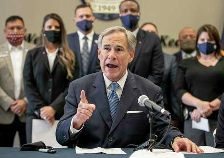 "Texas Gov. Gov. Greg Abbott speaks at a news conference before signing a ""Texas Backs the Blue Pledge"" at the Austin Police Association on Thursday Sept. 10, 2020, in Austin, Texas. ( Jay Janner/Austin American-Statesman via AP)"