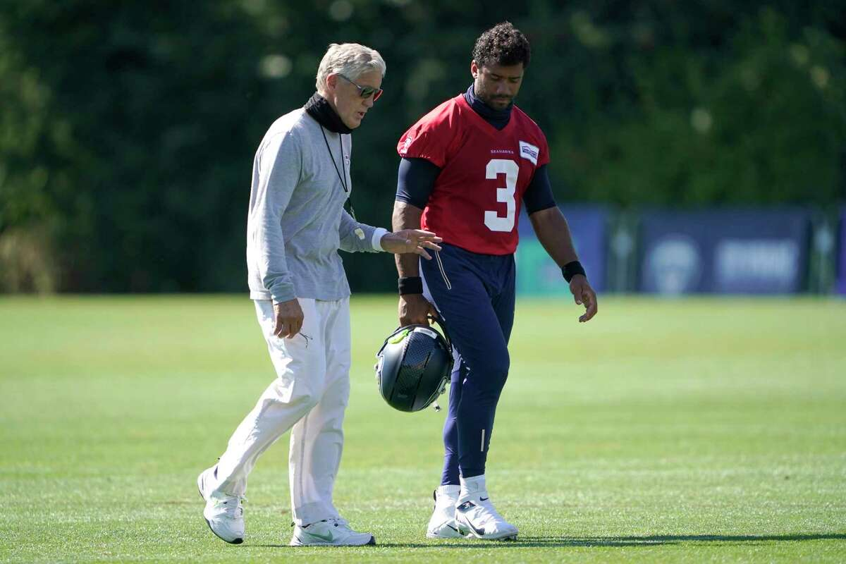 Seattle Seahawks quarterback Russell Wilson (3) walks with head coach Pete Carroll after the last day of NFL football training camp, Thursday, Sept. 3, 2020, in Renton, Wash.