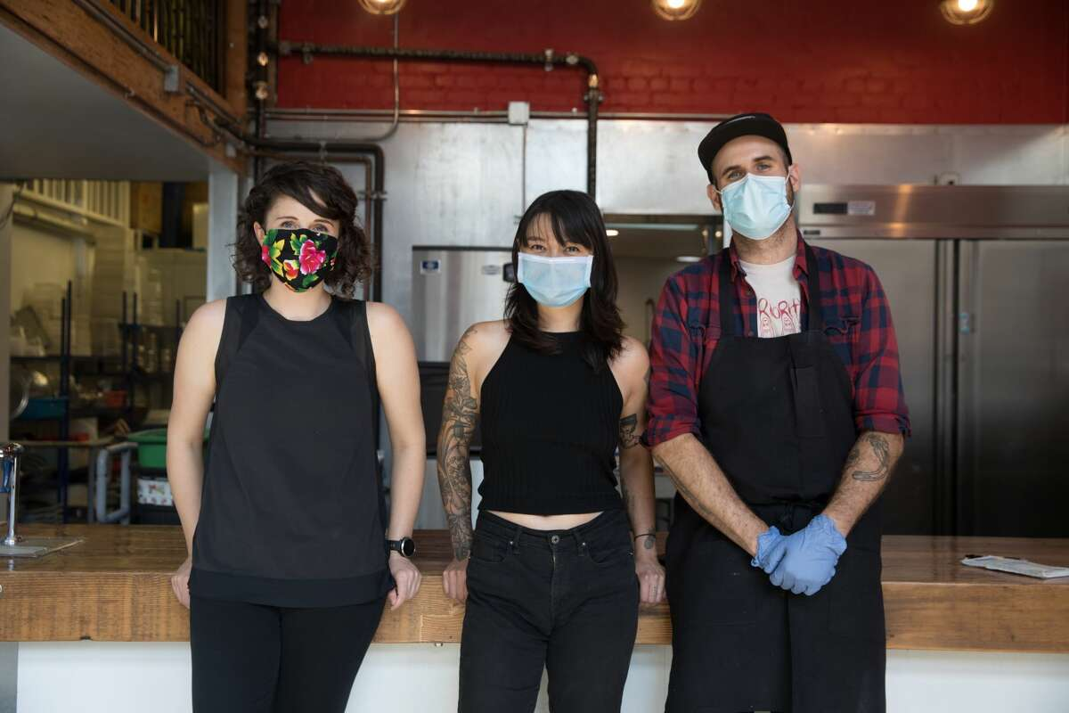 (Left to right) Rachel Metcalf, Cy Chia, and Shane Stanbridge are the co-owners of Lion Dance Cafe in Oakland on Sept. 4, 2020.