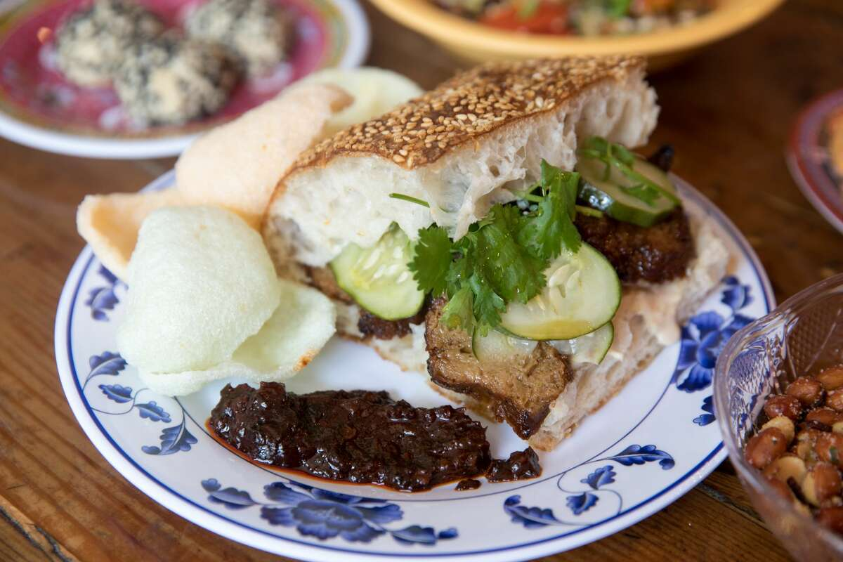Lion Dance Cafe's shaobing sandwich, consisting of vegan char siu, pickled cucumbers, cilantro with sesame cream and sambal belacan.