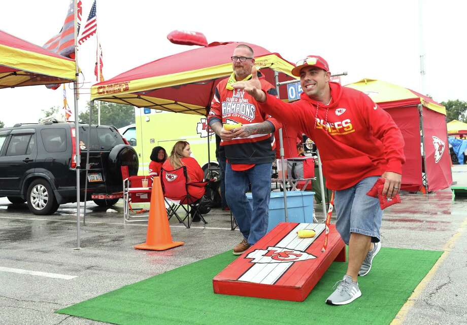 PHOTOS: See what the tailgating scene looks like at the Texans-Chiefs game in Kansas City KANSAS CITY, MISSOURI - SEPTEMBER 10: Kansas City Chiefs fans play corn hole while tailgating before the start of a game against the Houston Texans at Arrowhead Stadium on September 10, 2020 in Kansas City, Missouri. Photo: Jamie Squire, Getty Images / 2020 Getty Images
