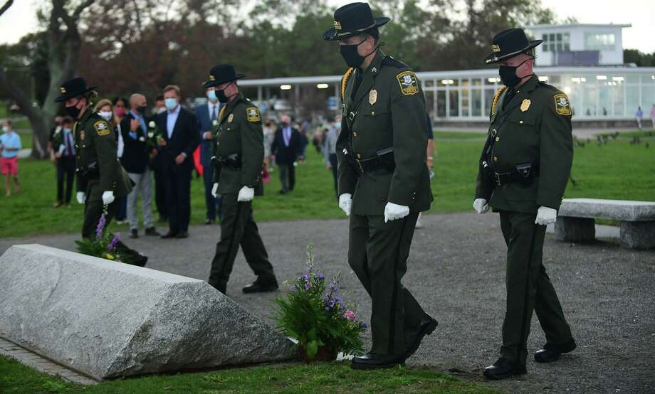 Troopers with the State Department of Environmental Protection flank the outdoor memorial as Connecticut holds the 19th annual 9/11 memorial ceremony Thursday, September 10th, 2020, at Sherwood Island State Park in Westport, Conn. The ceremony is held yearly to honor and celebrate the lives lost in the Sept. 11, 2001 terror attacks. Family members of those killed in the attacks participated in the ceremony, and the names of the 162 victims with Connecticut ties were read aloud. Photo: Erik Trautmann / Hearst Connecticut Media / Norwalk Hour