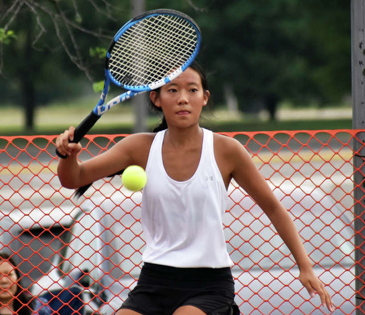 Edwardsville's Eileen Pan hits a return shot during her doubles match against O'Fallon on Thursday inside the EHS Tennis Center.