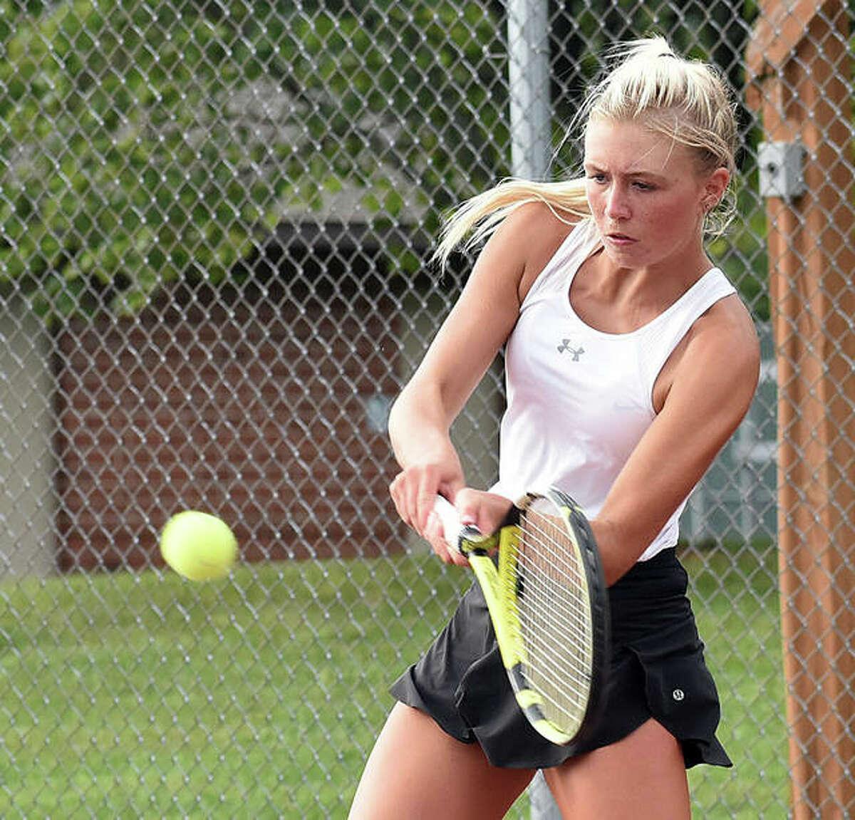 Edwardsville's Emma Herman slams a backhand shot during her doubles match against O'Fallon on Thursday inside the EHS Tennis Center.