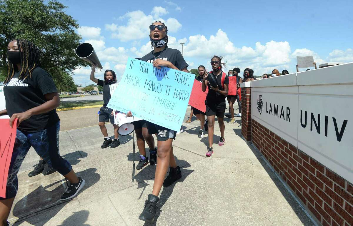 Lamar University athletes, staff and students join in a march through campus for equality, social justice and change led by the Lady Cardinals basketball team Thursday. Photo taken Thursday, September 10, 2020 Kim Brent/The Enterprise
